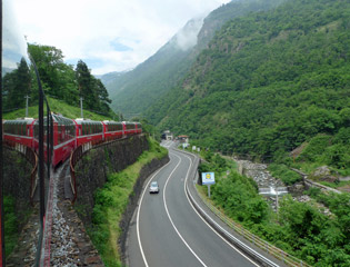The Bernina Express climbs up the valley from Tirano