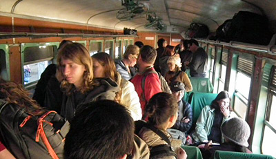 Westerners boarding the upper class car of the train to Lashio