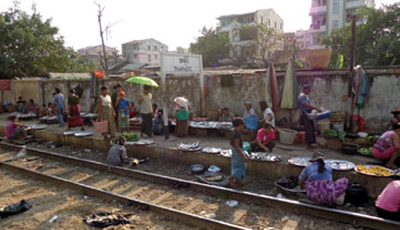 Market traders by the tracks of the Yangon Circle Train