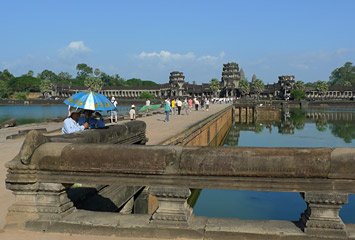 Crossing the moat to Angkor Wat