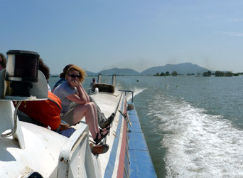 Sitting on deck on the speedboat to Siem Reap
