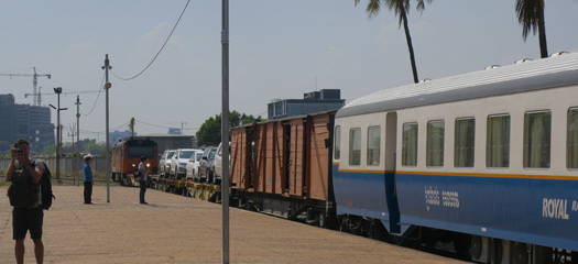Cambodian passenger train with car transporters