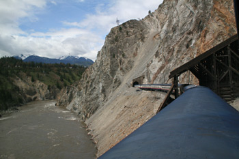 Rocky Mountaineer passing Avalanche Alley next to the Fraser River