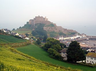 The Channel Islands:  Mont Orgeuil Castle, Jersey.  It's easy to reach Jersey by train & ferry.