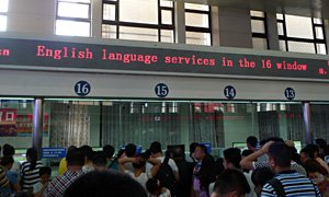 English language window at Beijing station ticket hall