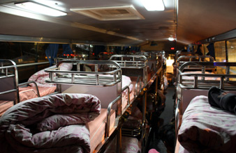 Inside the Kunming sleeper bus:  Berths are a bit short for taller travellers...