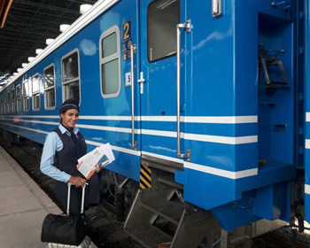 Attendant boards one of the new Cuban trains