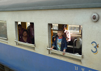 The E&O passes a Thai local train