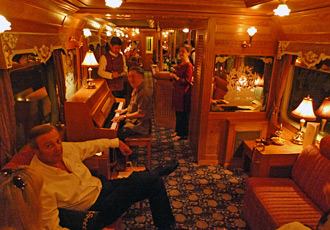 Evening fun in the Eastern & Oriental Express's piano bar car.
