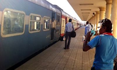 Boarding a daytime train from Luxor to Cairo at Luxor station