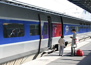 Train travel in France:  Boarding a high-speed TGV at Paris Gare de 'Est