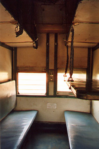 Interior of sleeper class car - bay of six berths.