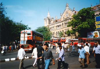 Red double-deckers outside Bombay Victoria Terminus...
