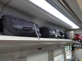 Overhead luggage racks on an indonesian train