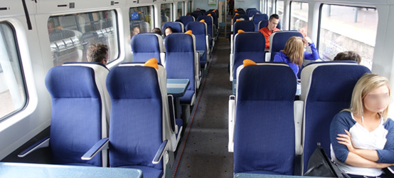 Standard class seating in an intercity railcar