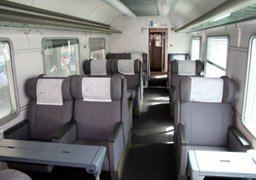 A first class compartment on an Italian InterCity train.