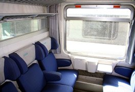 A second class compartment on an Italian InterCity train.