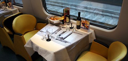 Restaurant car of a tilting 'Pendolino' train from Geneva to Milan.