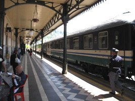 A sleeper train to Sicily at a wayside Italian station