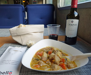 A table on the thello sleeper train to Venice, laid out for dinner
