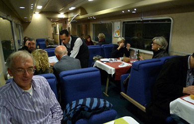 At dinner in the restaurant car of the Paris-Venice Thello sleeper train.