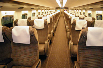 Train travel in Japan:  Comfortable 'green car' seats on a Series N700 Shinkansen train