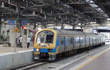 "KTM Komuter train inside Kuala Lumpur station"" width=""380"" height=""240"