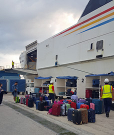 Loading luggage onto the ferry to Malta