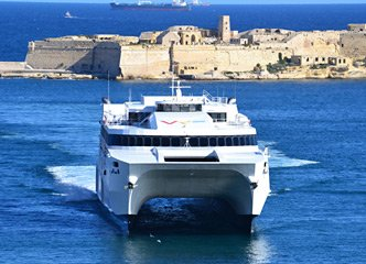 Virtu Ferries fast ferry from Sicily to Malta entering Valetta Harbour