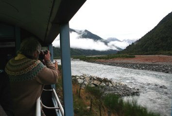 Taking photos from the open-air viewing platform on the Tranz-Alpine train