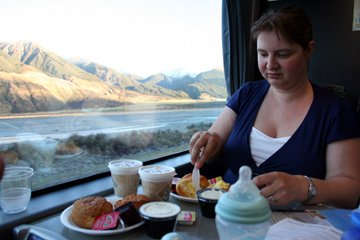 Enjoying a Devonshire cream tea on the Tranz-Alpine train...