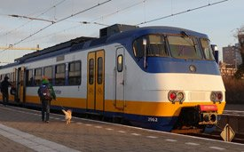 Sprinter train from Hoek van Holland to Rotterdam, change there for Amsterdam