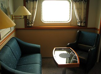 Seating area in a Hurtigruten deluxe cabin