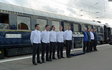 A line-up of VSOE train staff greets passengers at Calais