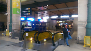 Escalators to left luggage at Paris Nord