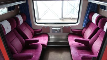 A first class open saloon car on the Berlin to Warsaw train