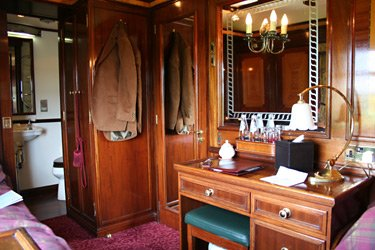 A twin-bed stateroom on the Royal Scotsman train