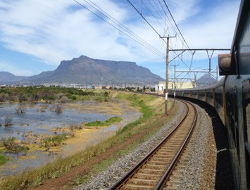 A Cape Town to Johnaeesburg train speeds away from Cape Town