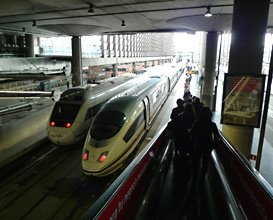 At Madrid Atocha, high-speed trains depart from a modern extension.