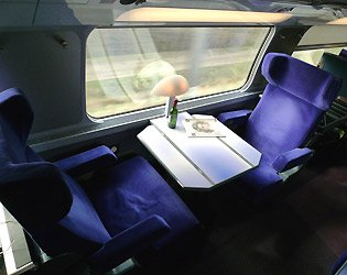 A first class 'club duo' table for two on the upper deck of the TGV Duplex train to Spain