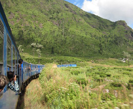 One of the new Chinese-built blue trains on the way to Kandy