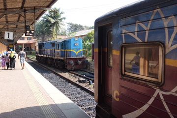 Locomotive runs round its train at Galle