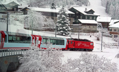 The Glacier Express passing a small Swiss village...