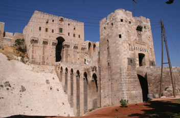 The magnificent gate to the citadel in Aleppo, Syria.