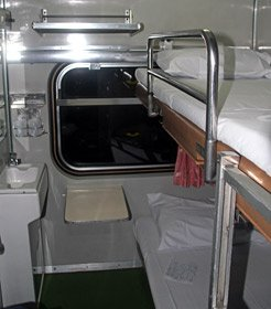 Thai 1st class sleeper in night mode with beds made up