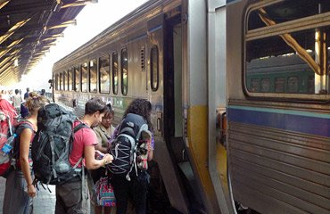 Passengers boarding the daytime express DRC train from Bangkok to Chiang Mai