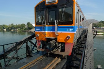 The weekend excusion railcar crosses the Bridge on the River Kwai