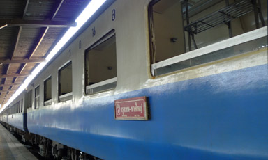 Exterior of 2nd class non-air-condiitoned sleepers on a Thai train.
