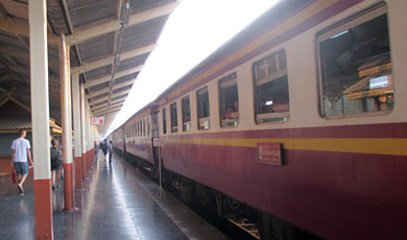 Exterior of older non-air-con carriages on a Thai express train