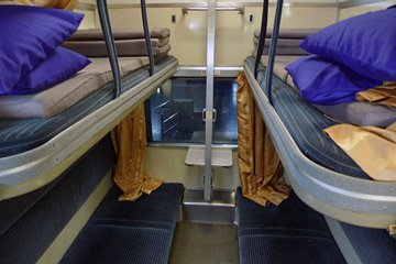 A bay of 4 sleeper berths on train 13 from Bangkok to Chiang Mai